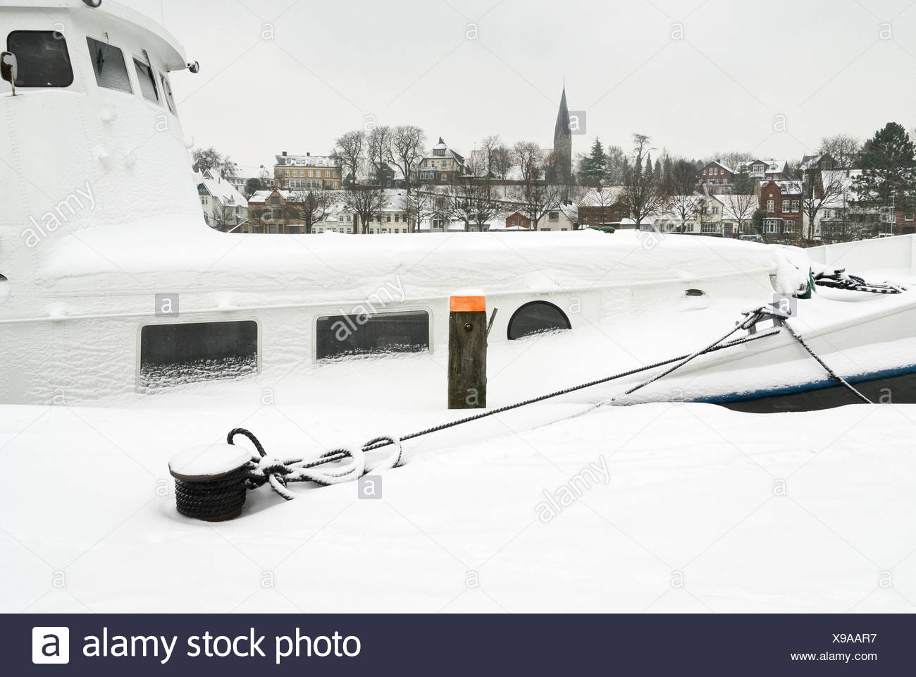 Moored ship in winter Stock Photo