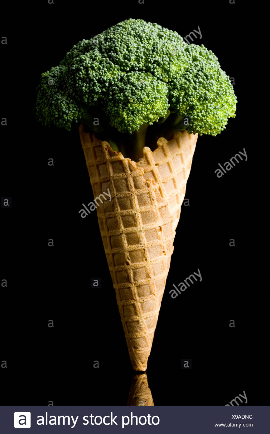 broccoli in a waffle ice cream cone - Stock Image