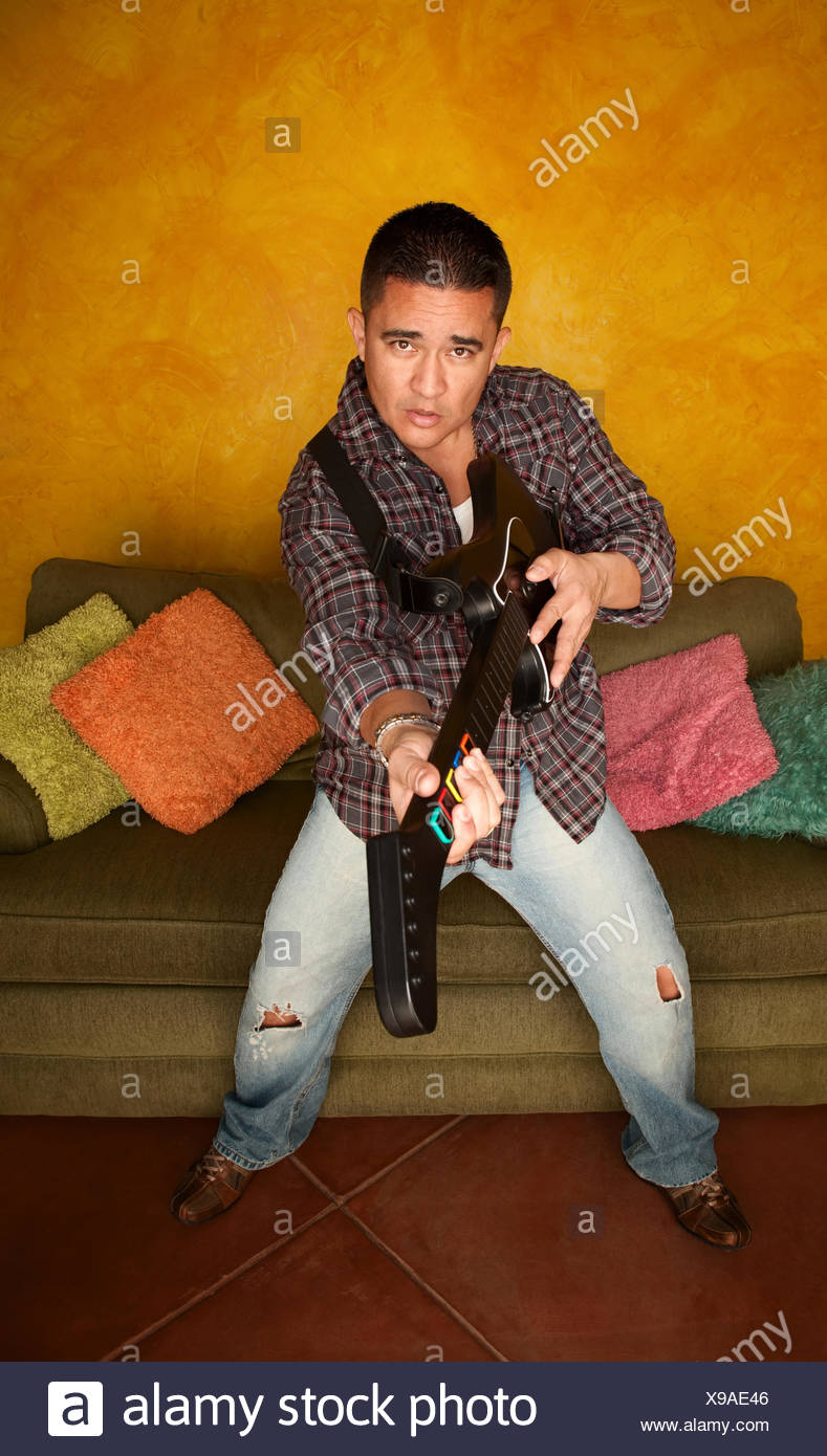 controller adult guitar - Stock Image