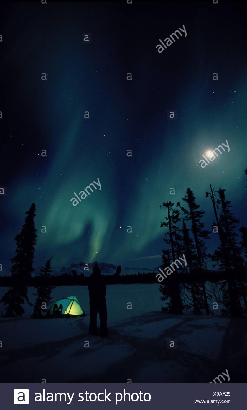 Northern Lights Over Tent Alaska Range SC - Stock Image
