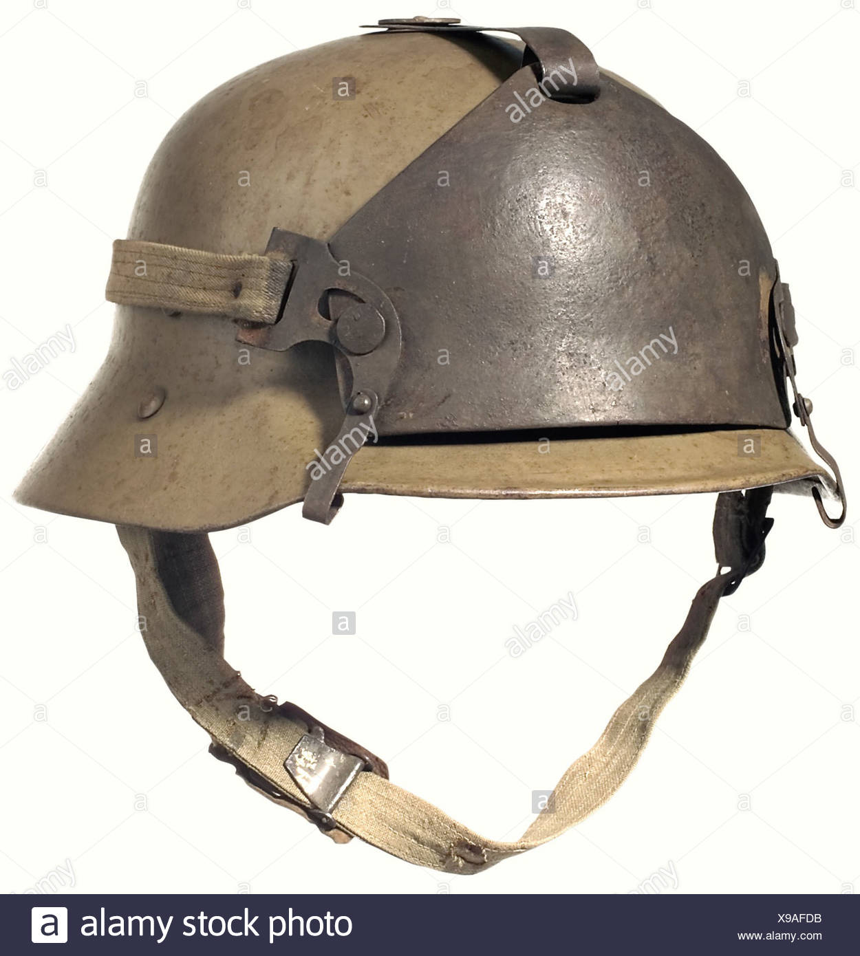 """A Berndorf type steel helmet with a supplementary front shield., Dirt-brown, lacquered steel bowl with the rim turned under and four ventilation holes on top covered by a flat steel plate. Fabric chinstrap fastened by rivets. Three rivets for attaching the lining. Leather lining on leather fastening rings as in the German model 16/1st version. No maker's mark or size designation. Forehead armour of cast steel (1111 g) with fastening hooks of plate steel, fabric fastening straps (a bit short). Cf. Rest/Ortner/Ilming, """"Des Kaisers Rock"""", p. 158 ff. historic, hist, Stock Photo"""