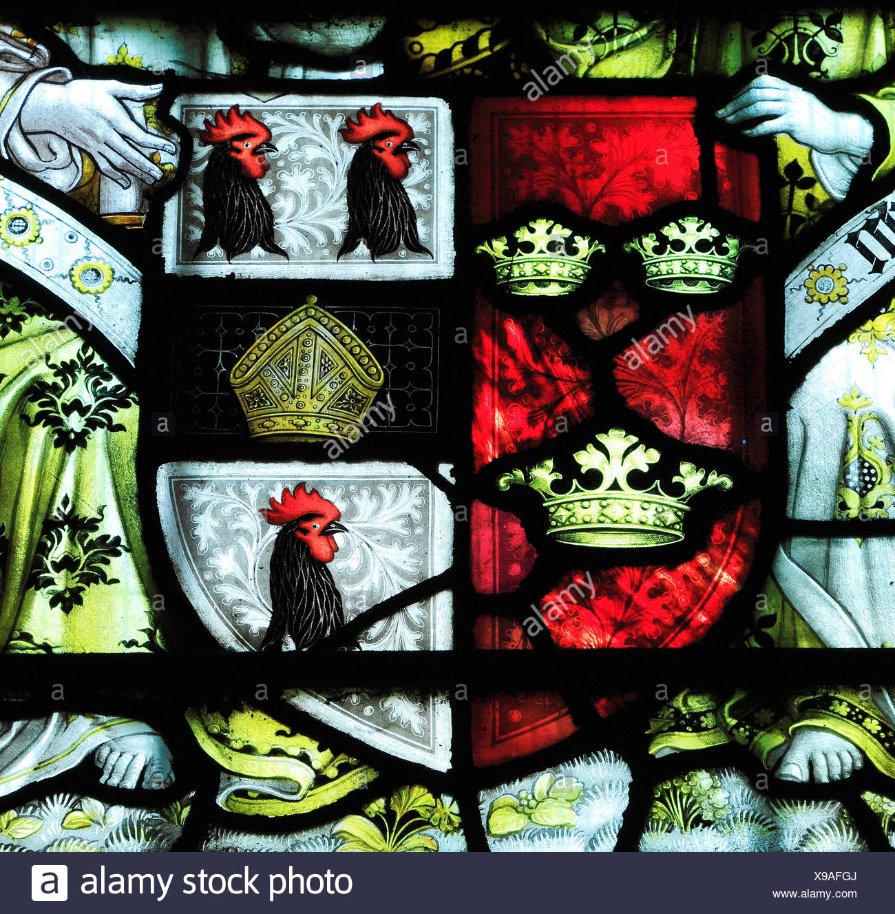 Ely Cathedral, arms of Bishop Alcock, stained glass window, heraldry heraldic cockerels English medieval bishops - Stock Image