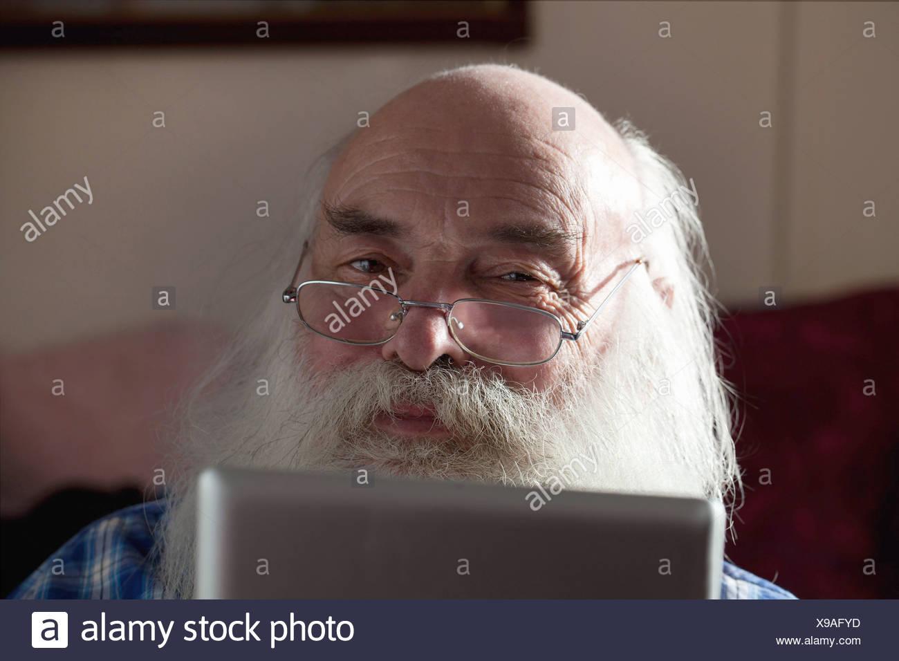 Senior man using digital tablet - Stock Image