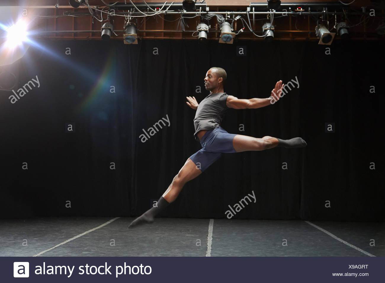 Dancer in midair pose Stock Photo