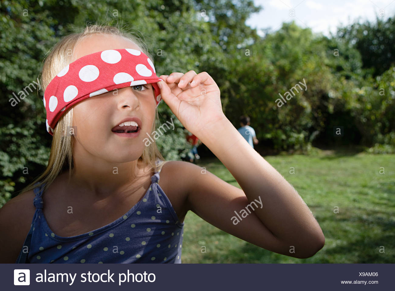 Girl playing hide and seek - Stock Image