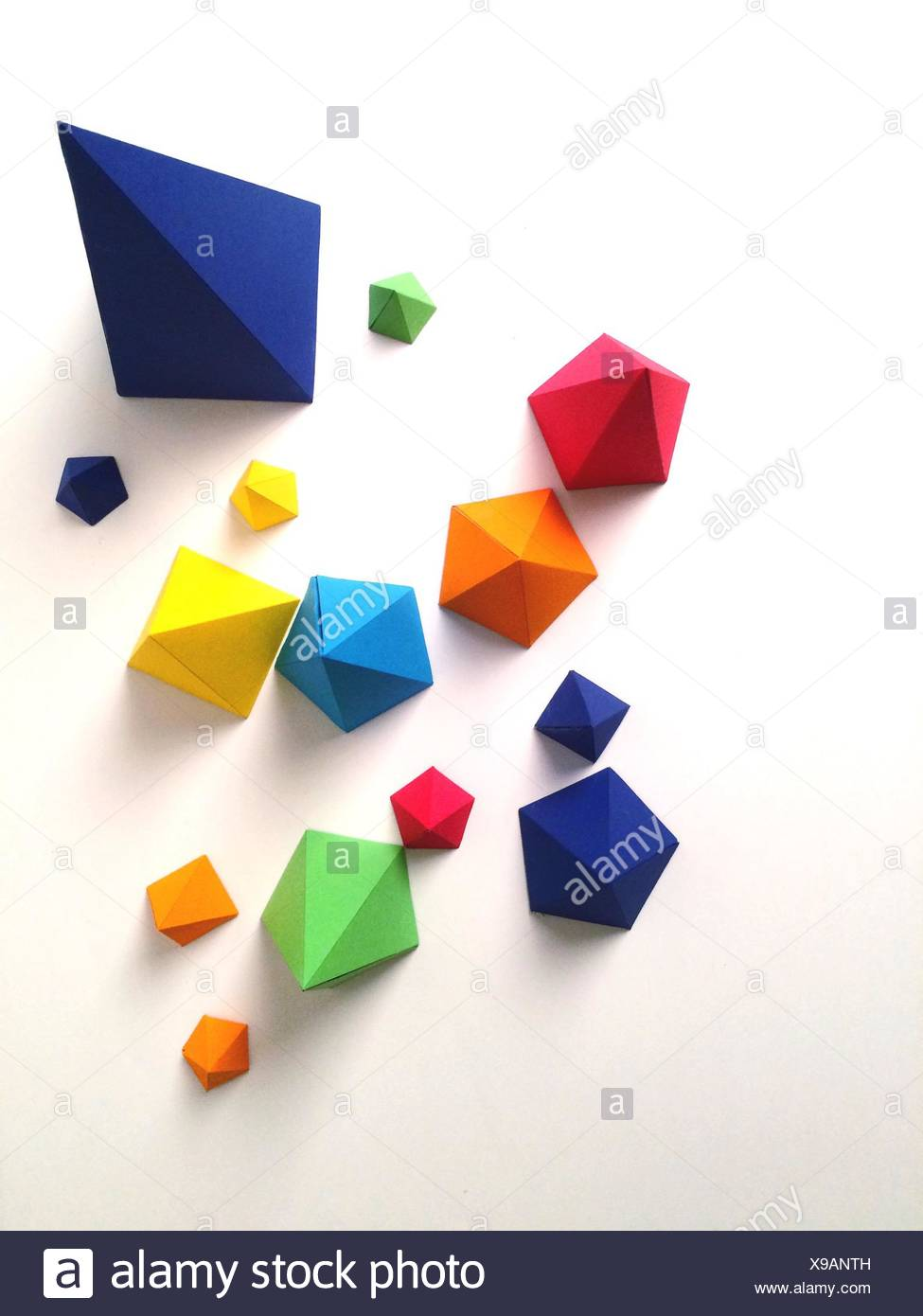 High Angle View Of Multi Colored Paper Pyramids - Stock Image