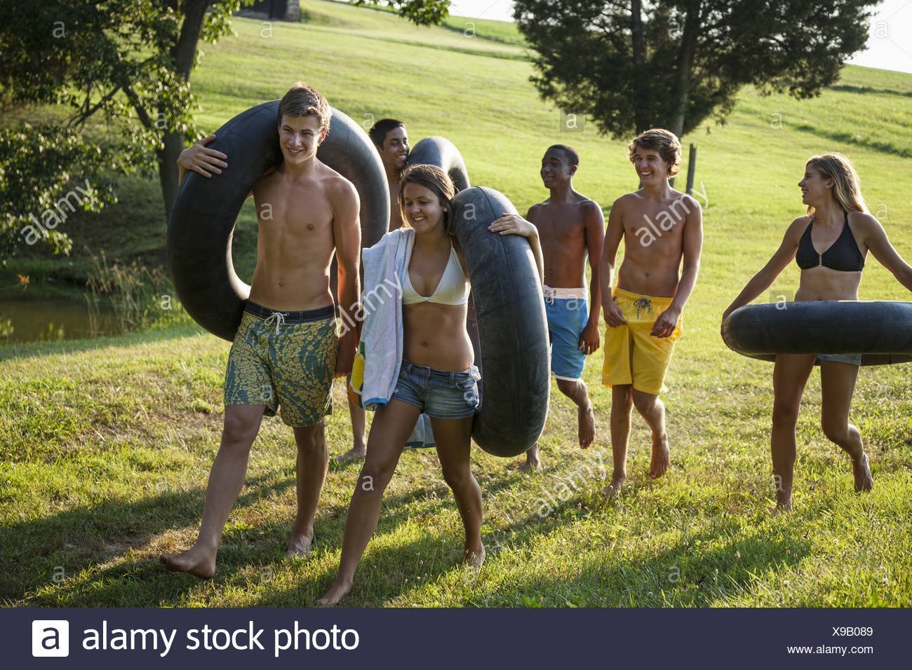 Maryland USA boys and girls holding towels swim floats for swim - Stock Image