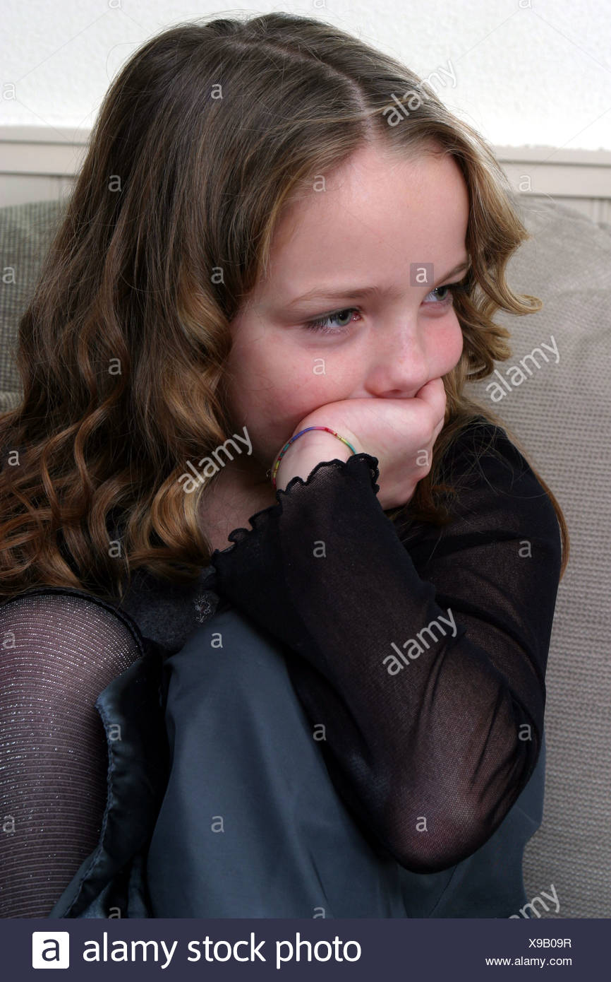 Sad girl about 8 years old Stock Photo