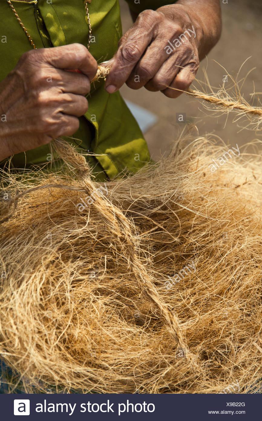 India Kerala Cochin Senior Woman Making Ropes With