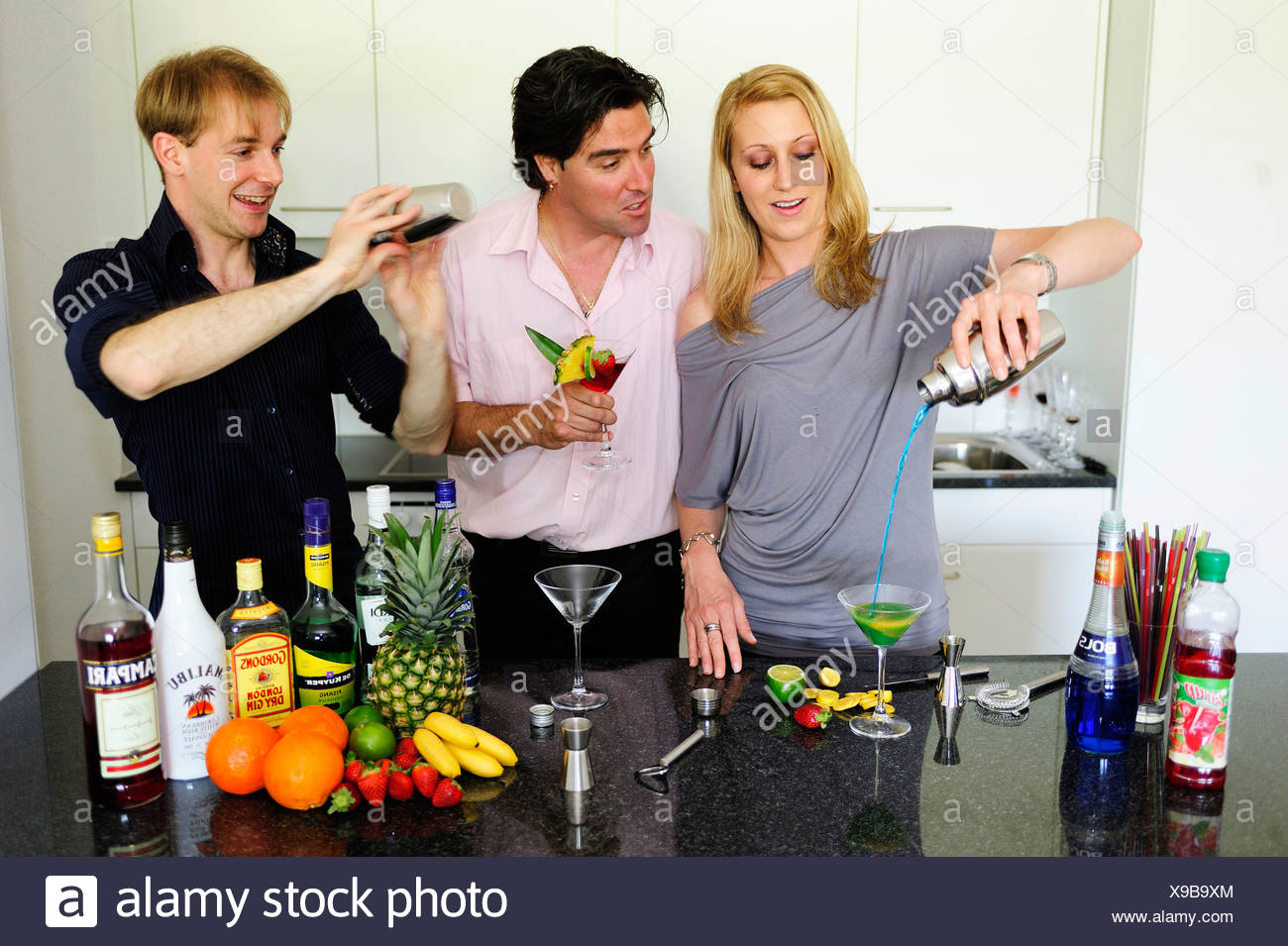 Friends at the bar mixing drinks Stock Photo