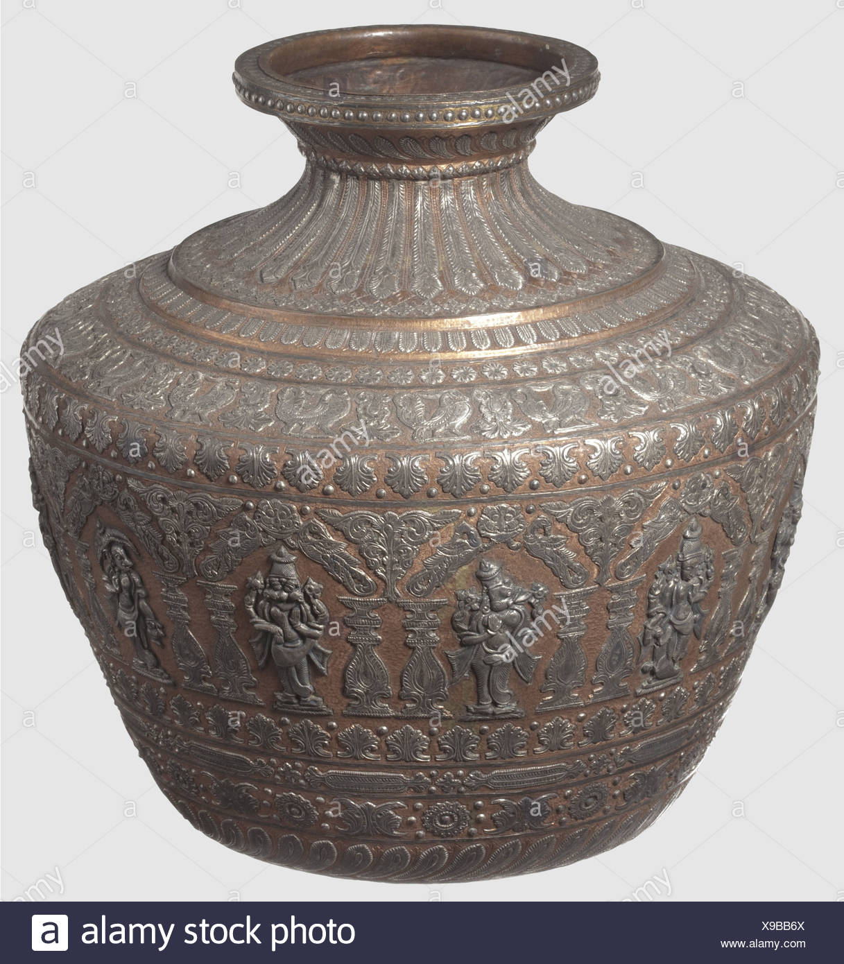 A southern Indian magnificent silver-inlaid vase, 19th century Tapered and chased body made of copper with short, flared neck. The exterior is completely inlaid with beaded bands, peacocks and deities. Rich ornamental decorations with finely engraved and chiselled silver. The silver darkened in some parts. Elaborately worked vase in good condition. Height 31.5 cm, historic, historical, 19th century, object, objects, stills, clipping, clippings, cut out, cut-out, cut-outs, fine arts, art, artful, Additional-Rights-Clearences-NA - Stock Image