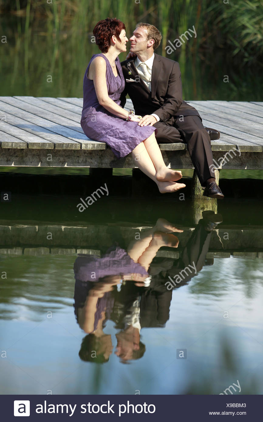 a couple in love on the pier at the lake Stock Photo