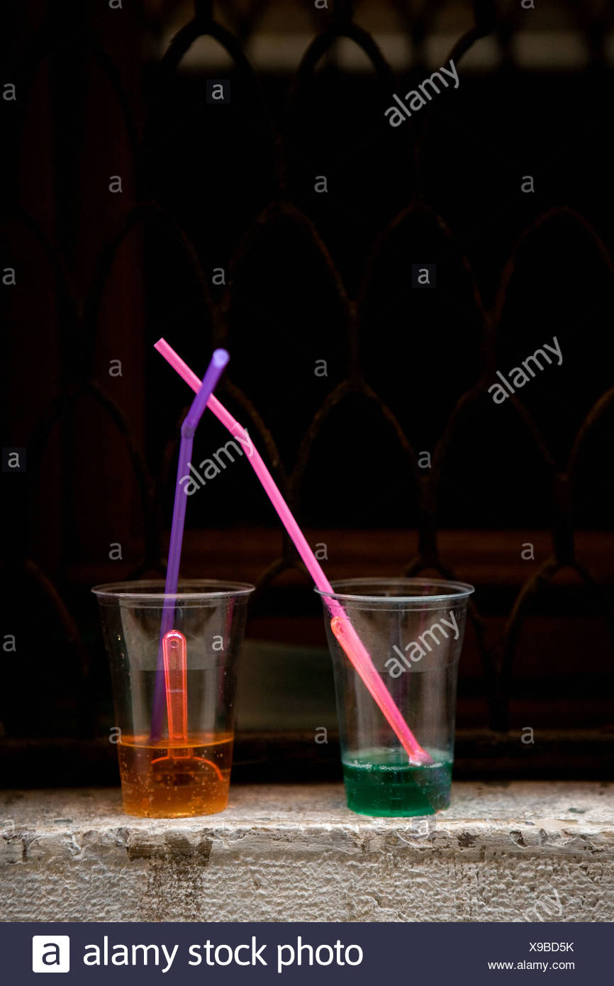Two fizzy drinks with drinking straws - Stock Image