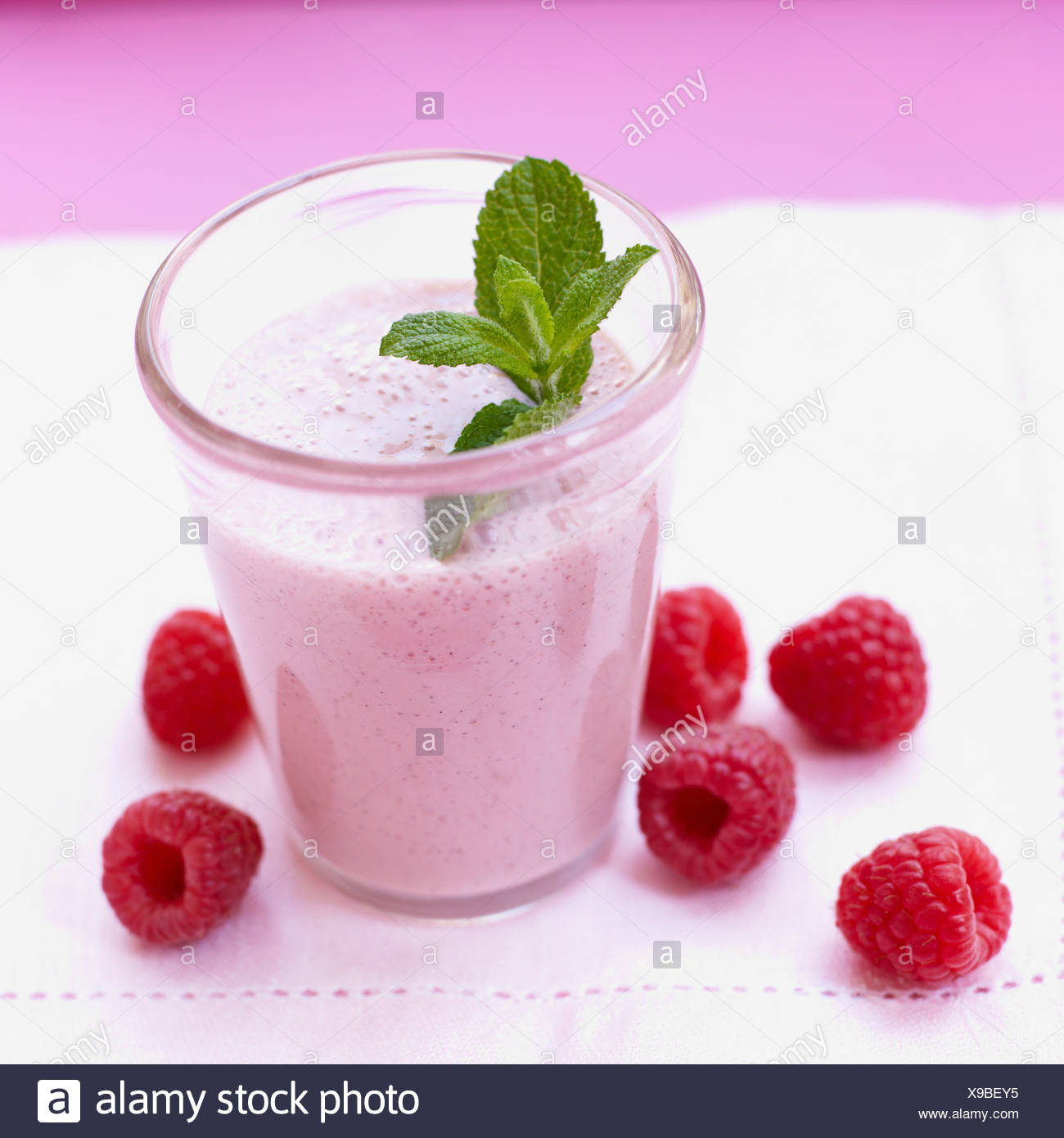 Raspberry shake with mint leaf Stock Photo