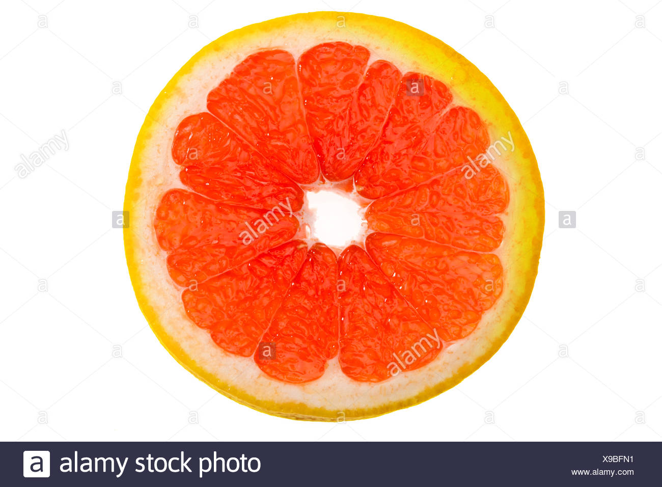 close up view of fresh grapefruit slice on white - Stock Image