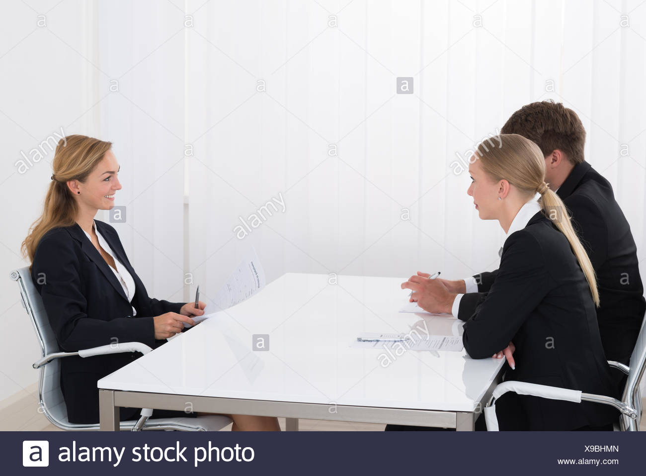 Female Manager Interviewing An Applicant - Stock Image