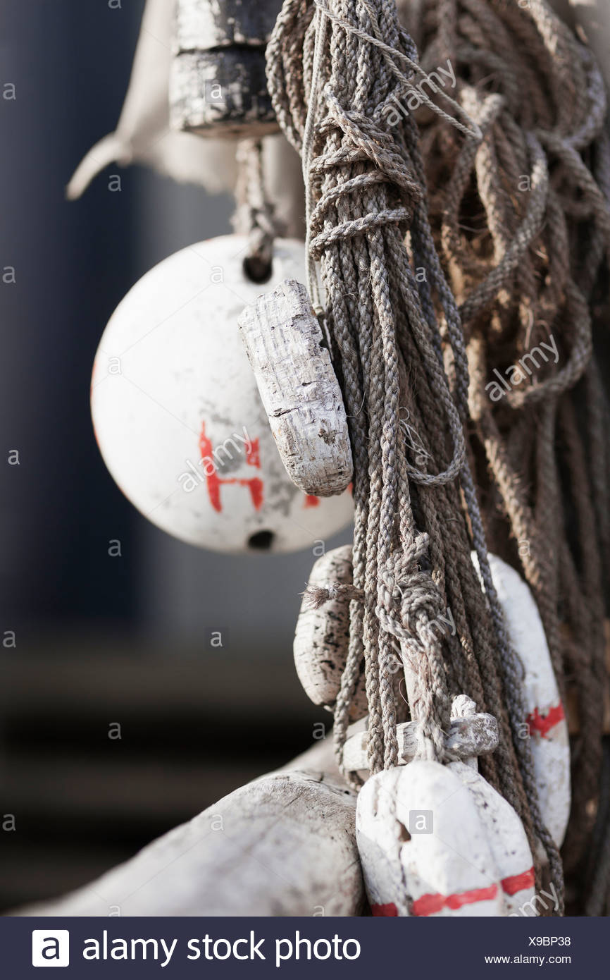 Close-up of rope and buoys Stock Photo