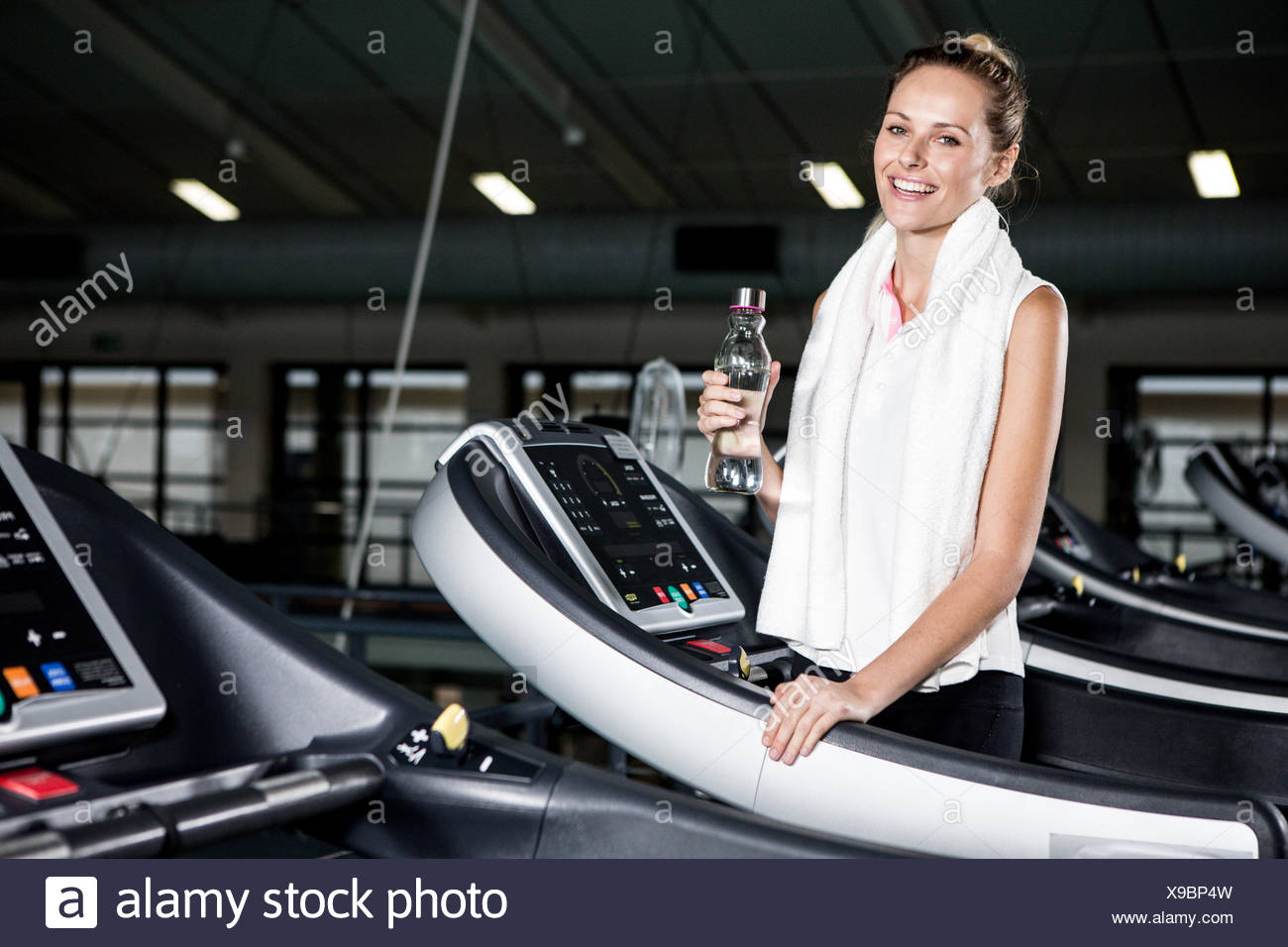 Woman holding water bottle - Stock Image
