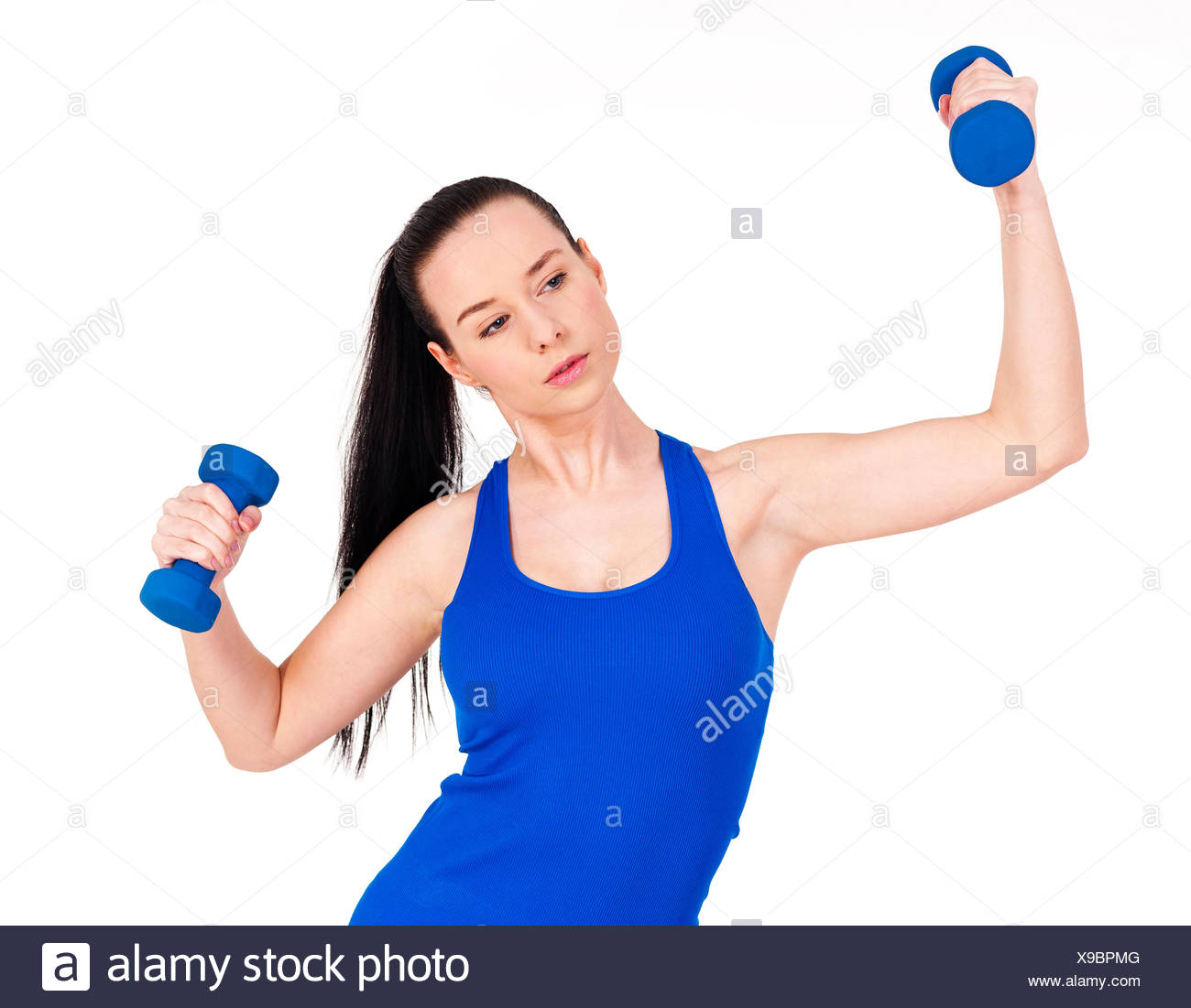 Focus woman exercising with dumbbell Debica, Poland - Stock Image