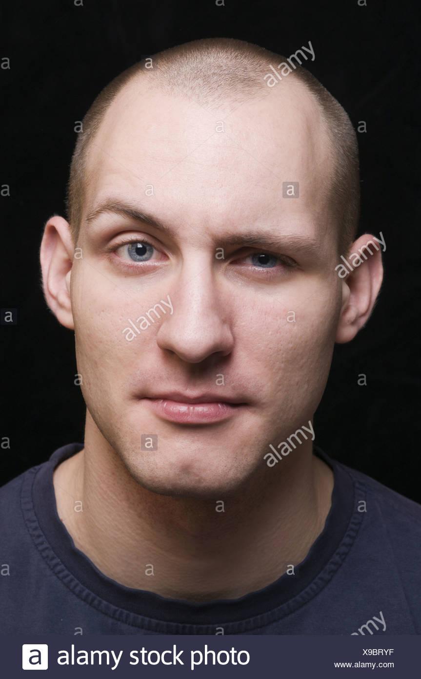 young man grimacing - Stock Image