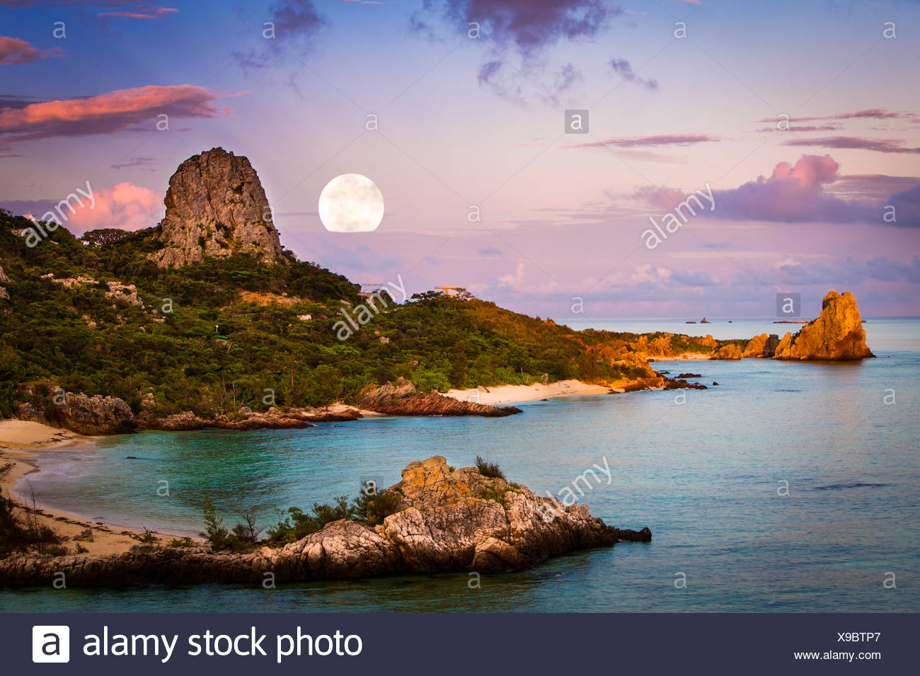 Moon over coastal landscape, okinawa, japan - Stock Image