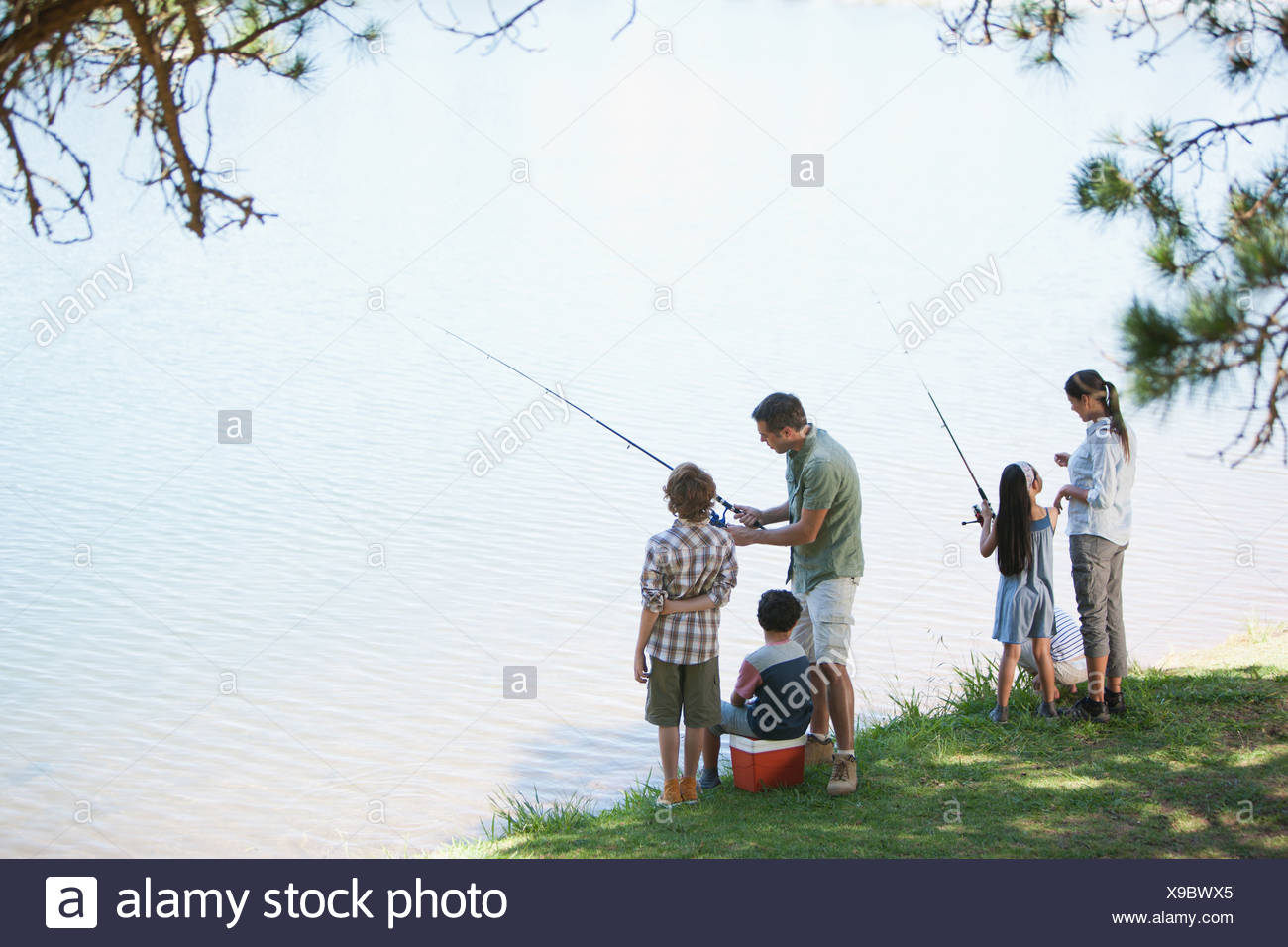 Family fishing lakeside - Stock Image