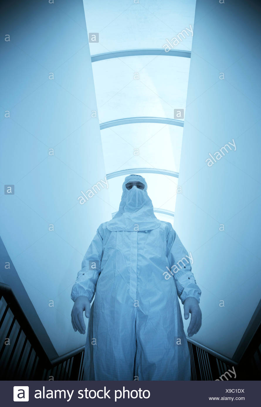 Scientist in an isolation suit Stock Photo