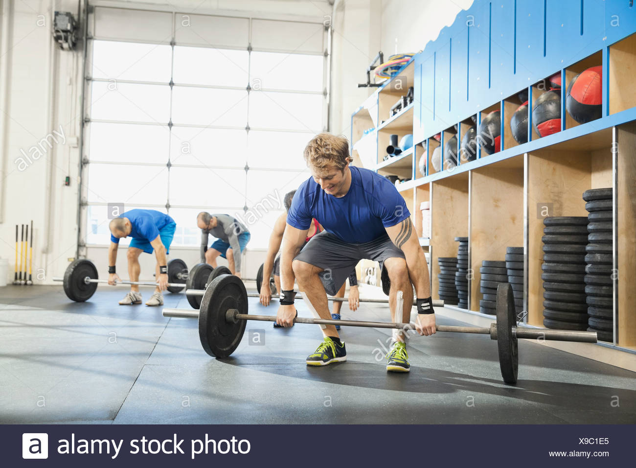 Man getting into position for clean and jerk lift - Stock Image