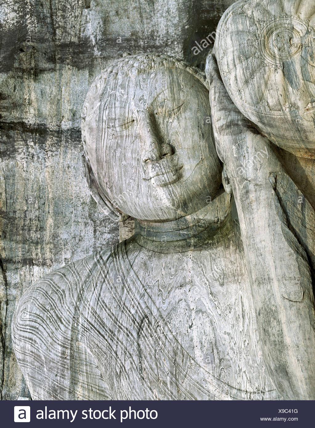 Gal Shiva god's figures head ruins Polonnaruwa Sri Lanka Asia - Stock Image