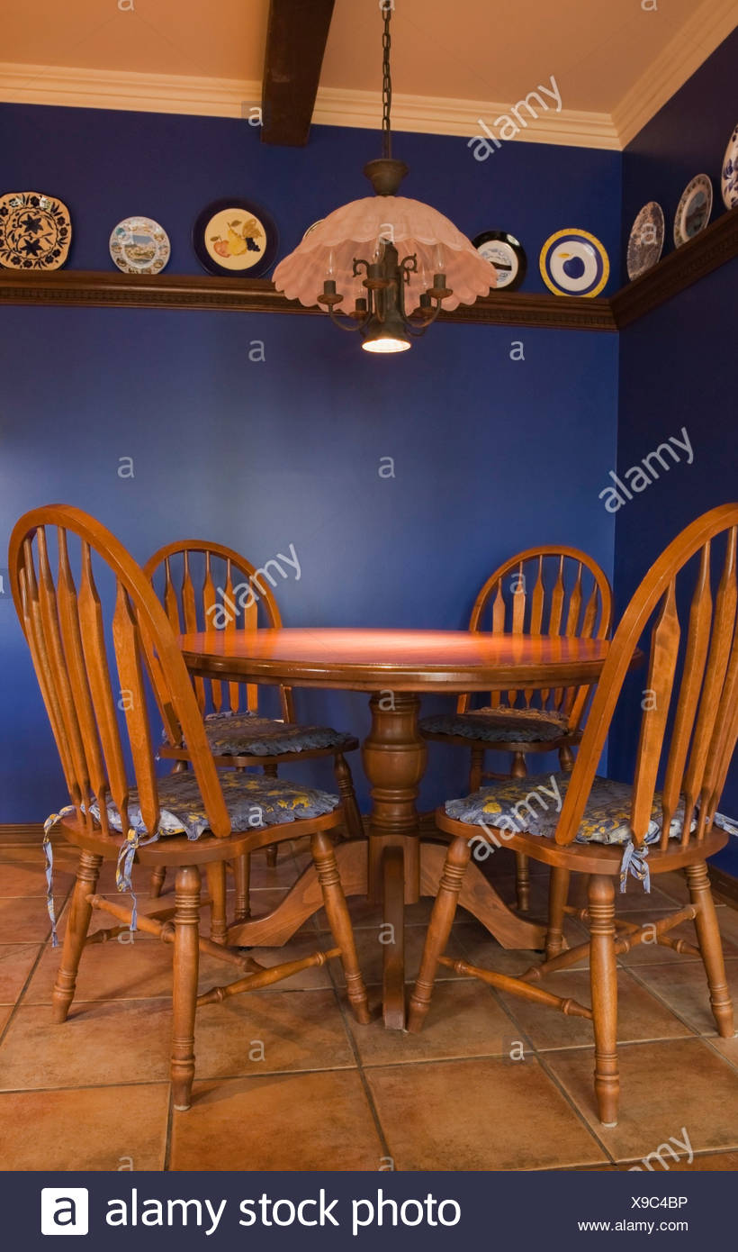 Antique table and chairs in the kitchen of a 1998 reproduction of an old  Canadiana cottage style residential Home, Quebec - Antique Table And Chairs In The Kitchen Of A 1998 Reproduction Of An