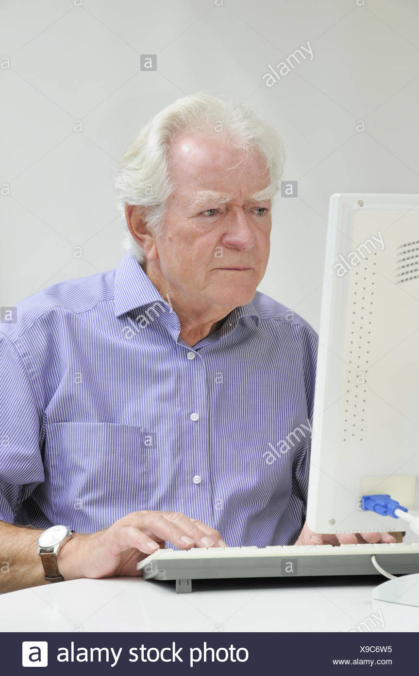 Senior with computer - Stock Image