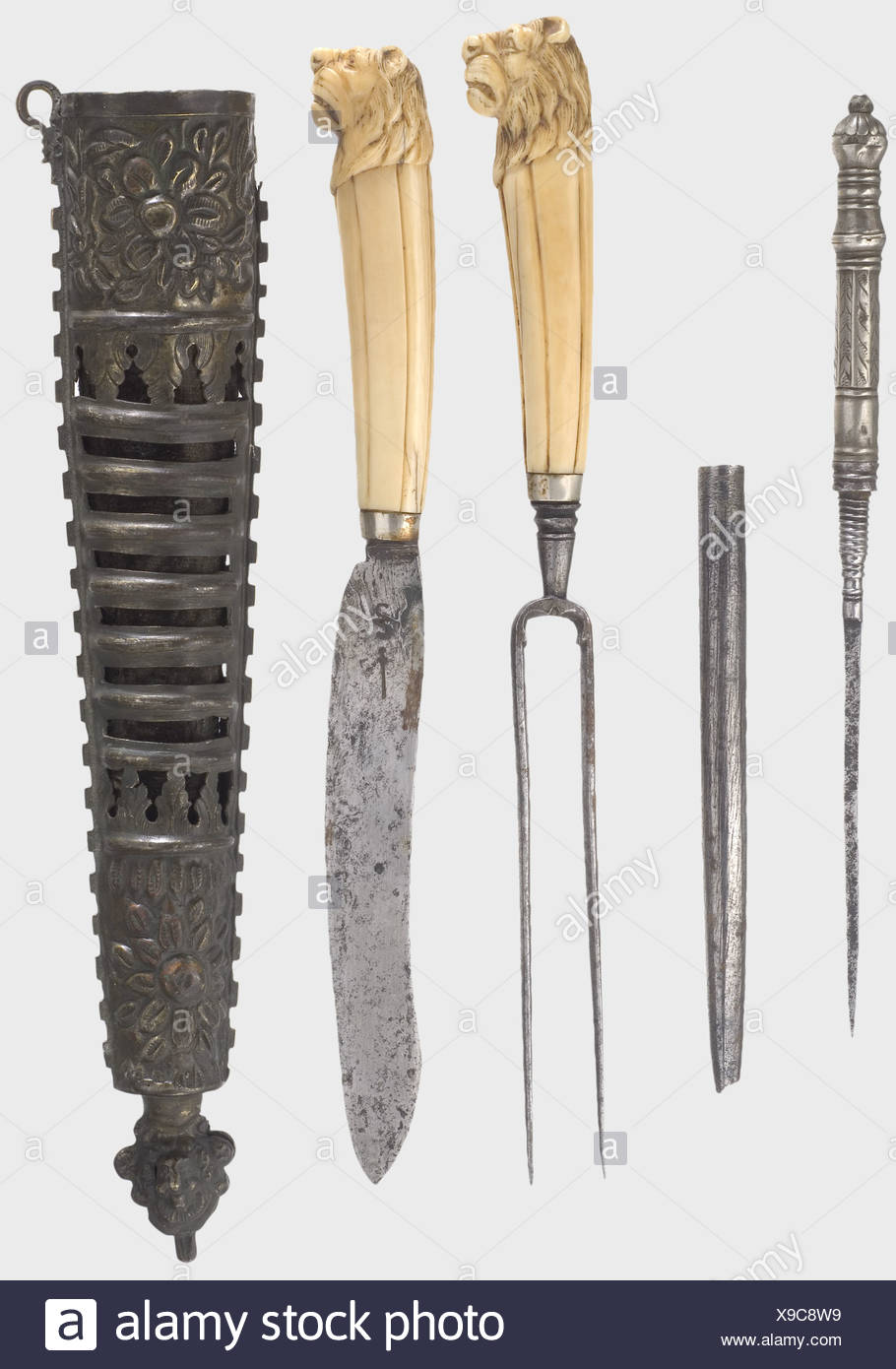 A set of German hunting cutlery, 18th century. Matching knife and fork with ivory handles, the pommel of each carved as a lion head. Non-matching sharpening steel with a nickel-silver handle which unscrews and an awl inside. Openwork scabbard embossed with floral designs and a three-piece wooden insert. Length 32 cm. historic, historical, 18th century, dagger, daggers, thrusting, thrustings, baton, weapon, arms, weapons, arms, fighting device, object, objects, stills, clipping, cut out, cut-out, cut-outs, Additional-Rights-Clearances-NA - Stock Image
