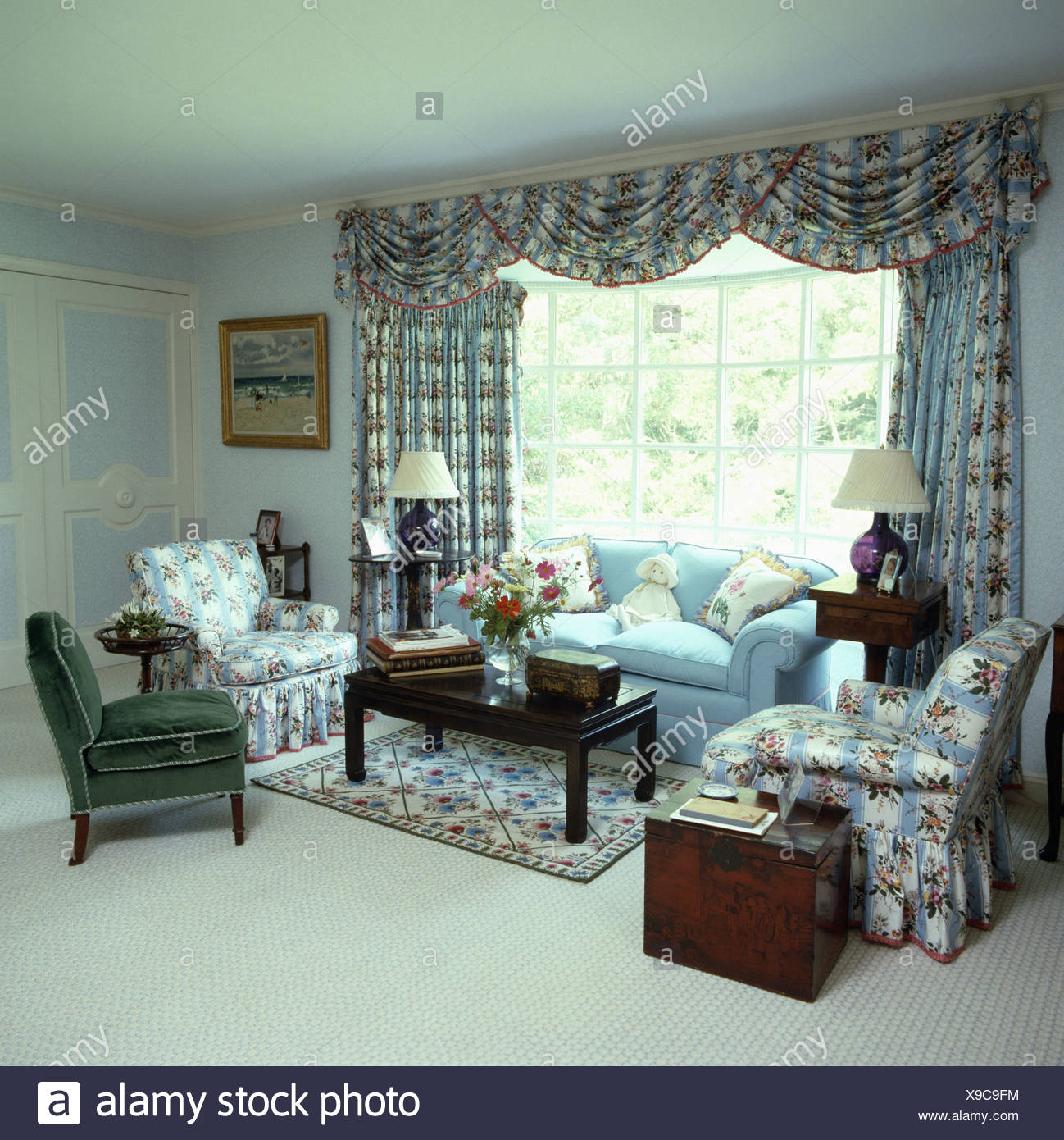 Blue Pink And White Floral Patterned Drapes And Armchairs In Pale Blue Living Room With White Carpet And Antique Chest Stock Photo Alamy