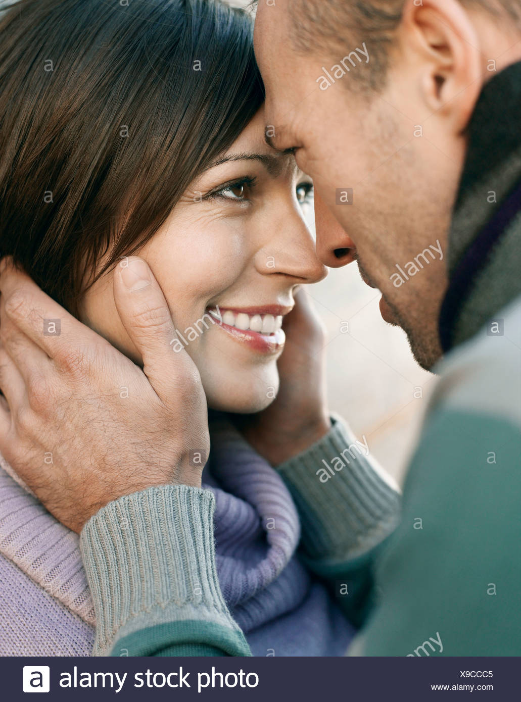 Couple looking in each others eyes, outdoors, close up - Stock Image