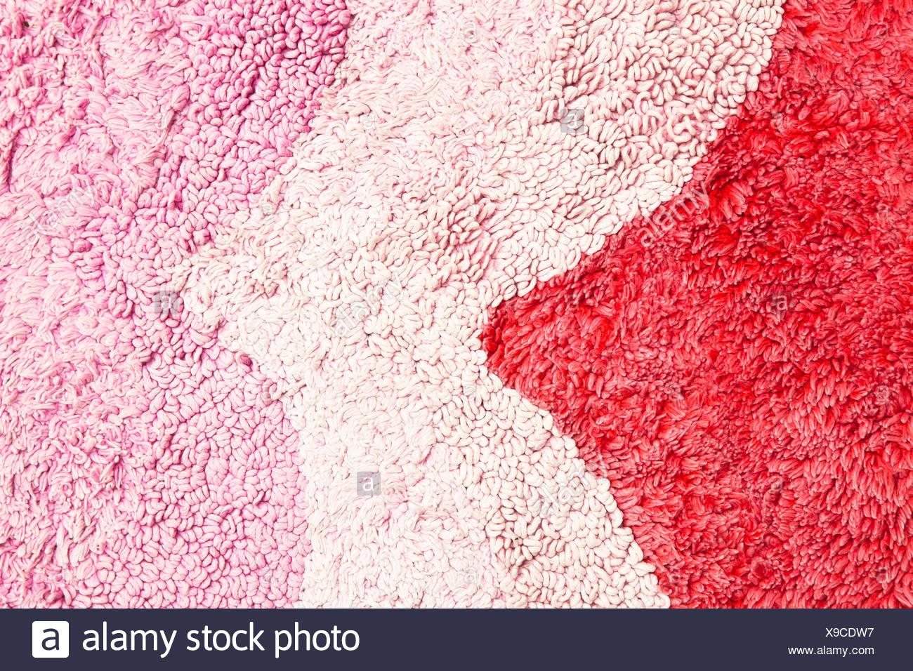 Pink rug - Stock Image