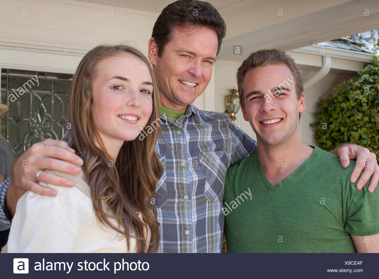 Portrait of father with adult offspring - Stock Image