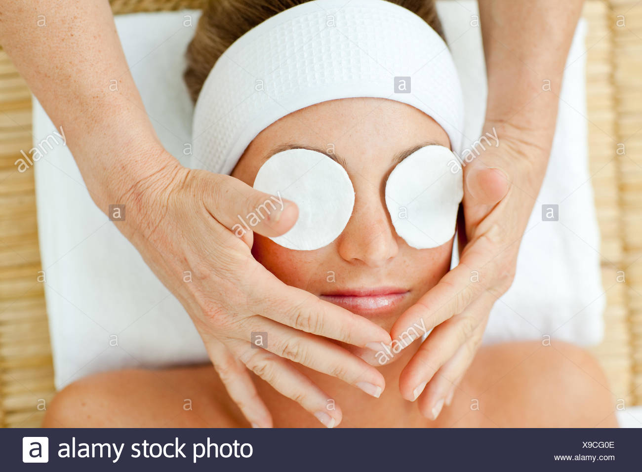 Pretty woman relaxing with a head massage - Stock Image