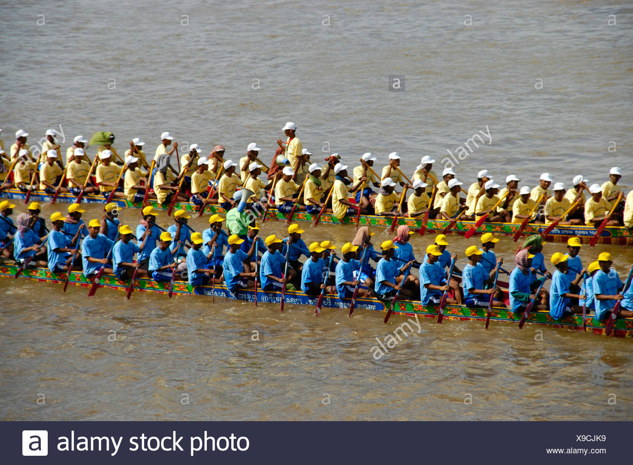 Big rowing boats, rowers, competition, water festival, Phnom Penh, Cambodia, Southeast Asia Stock Photo