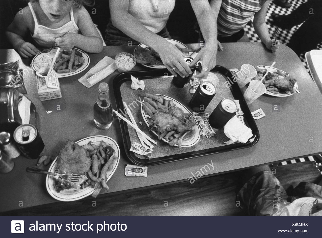 Family having junk food meal - Stock Image