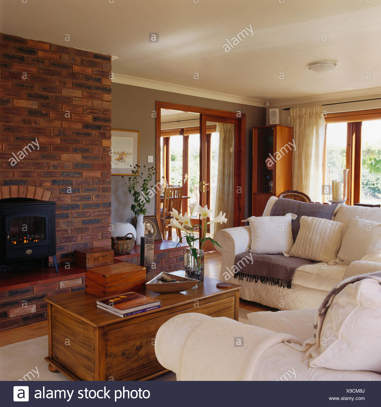 Marvelous White Sofas And Old Pine Chest Around Fireplace With Wood Creativecarmelina Interior Chair Design Creativecarmelinacom