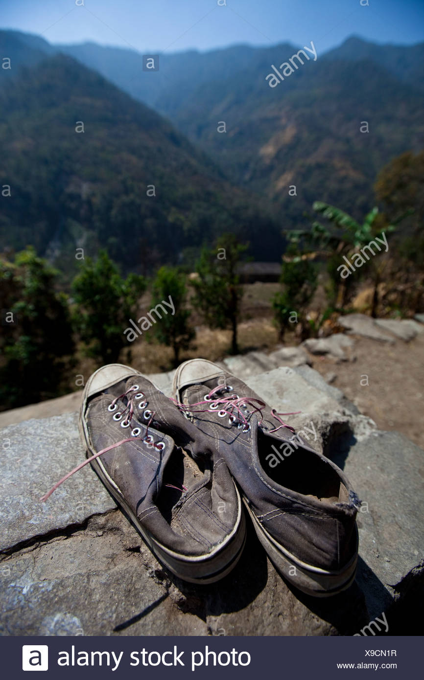 Old shoes point off towards the Himalayan foothills in Nepal. Stock Photo