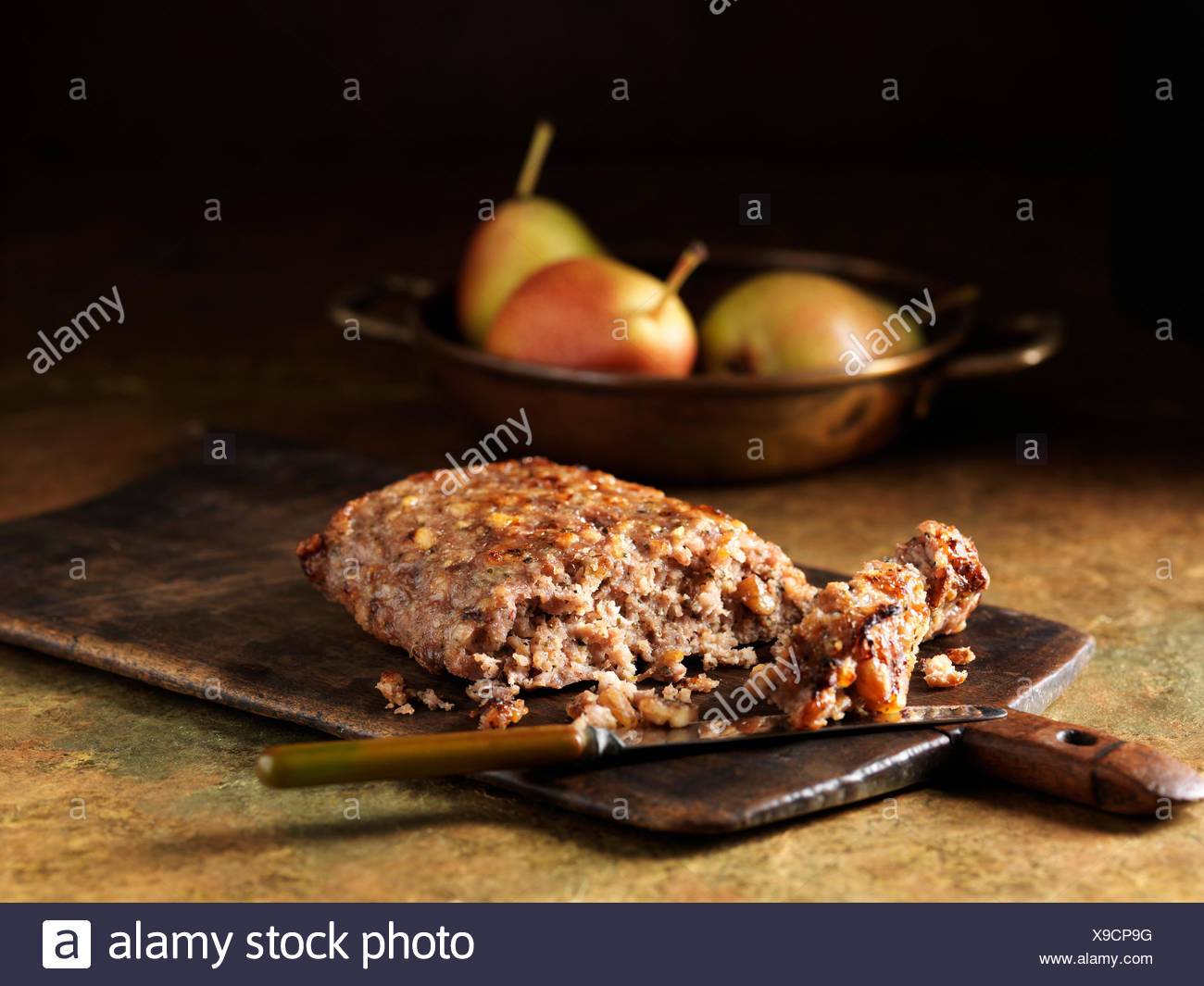Festive Christmas ingredients of pork, pear and walnut stuffing with pears - Stock Image