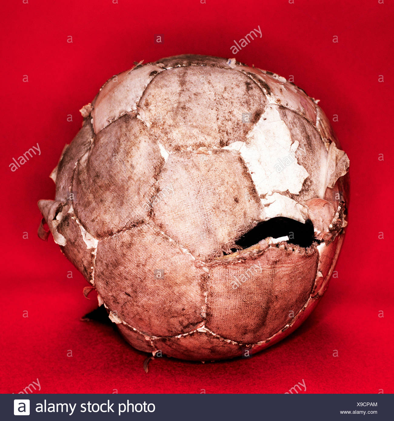 Worn out football - Stock Image
