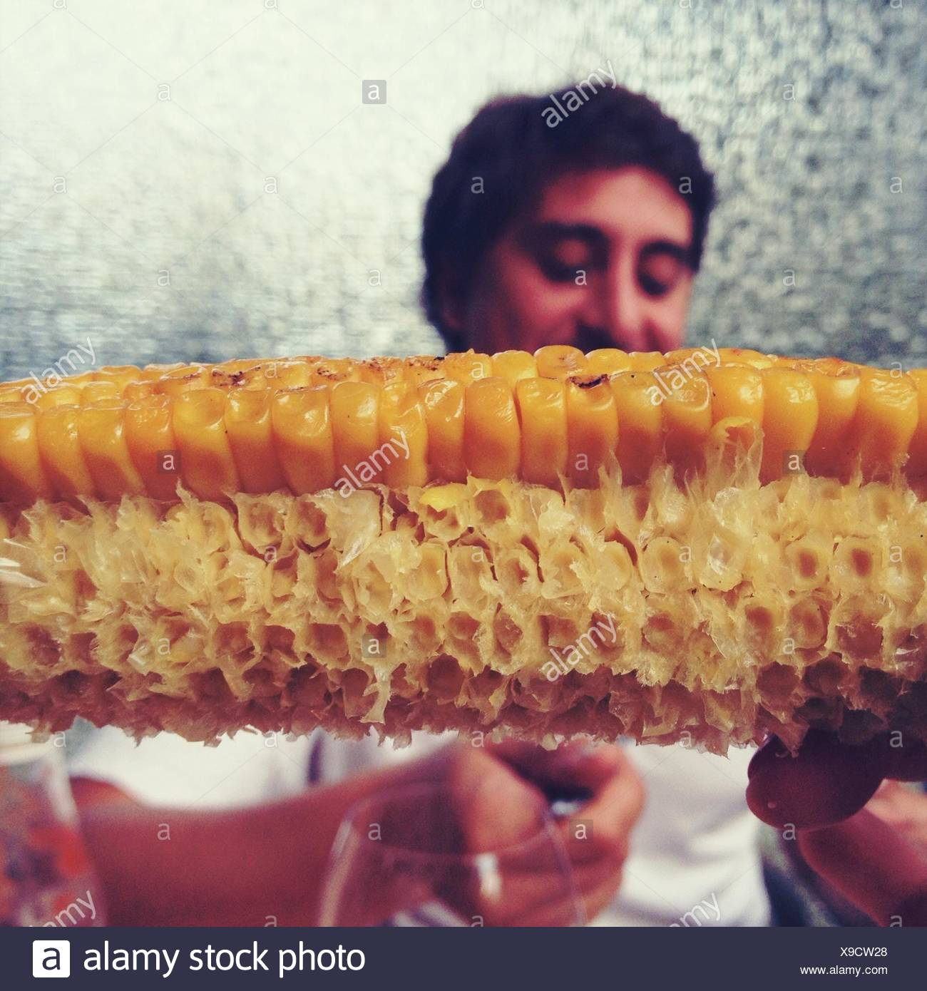 Detail Of Eaten Corn With Man In Background - Stock Image
