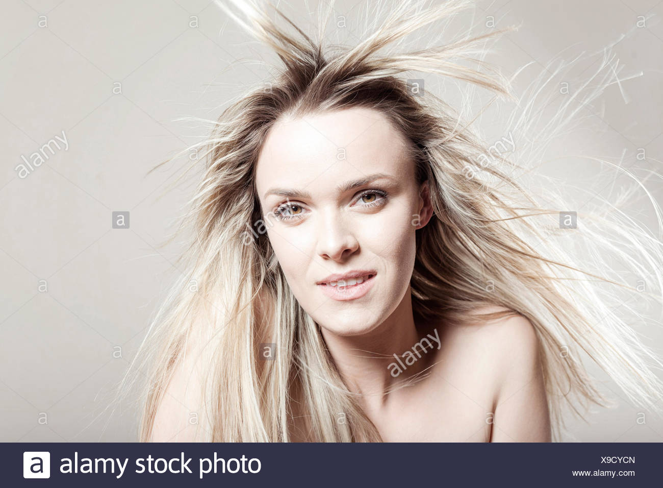 Young woman with tousled hair Stock Photo