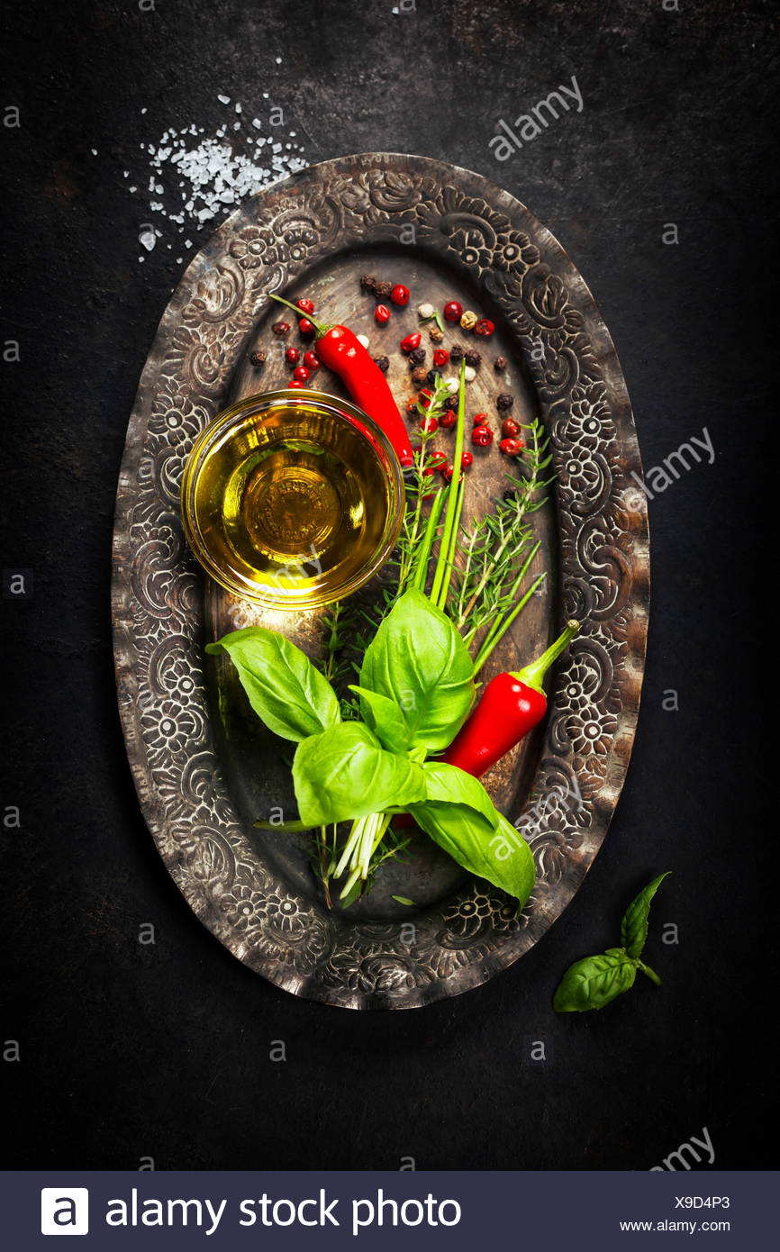 Herbs and Spices on vintage plate - Stock Image