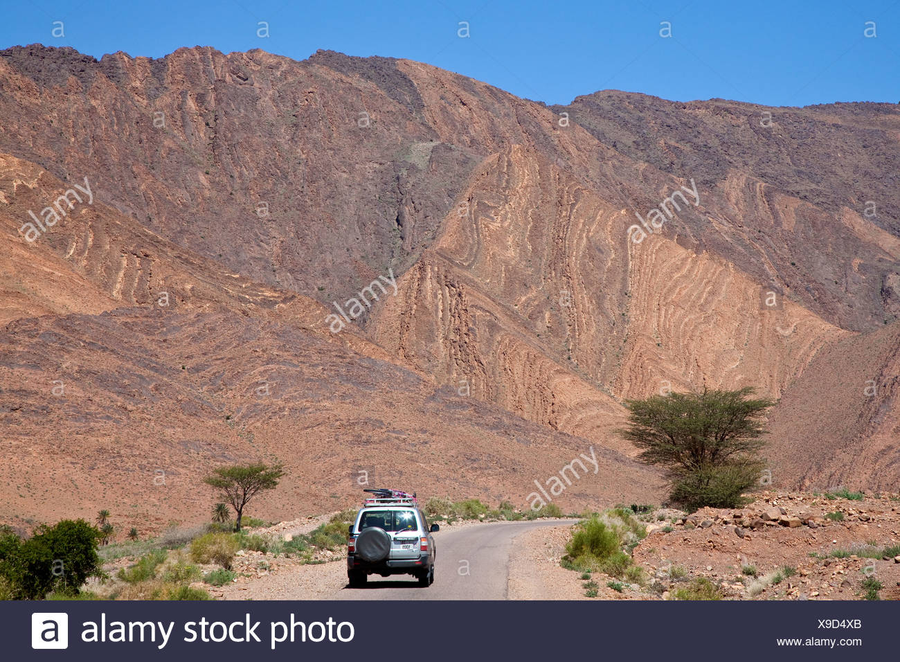 All-terrain vehicle, Toyota Land Cruiser, driving on a road near Foum-Zguid, Morocco, Africa - Stock Image