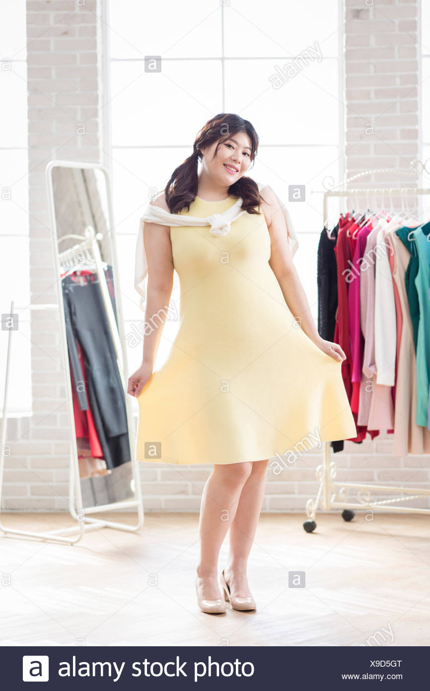 Young Smiling Fat Woman In Yellow Dress Posing Stock Photo Alamy