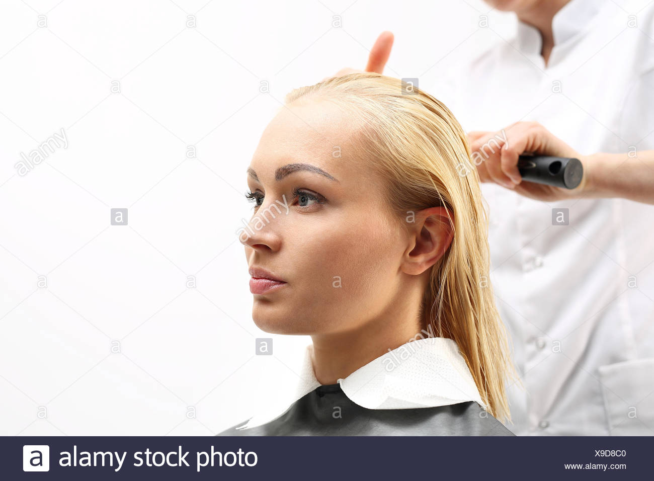 dry your hair on a round brush - Stock Image