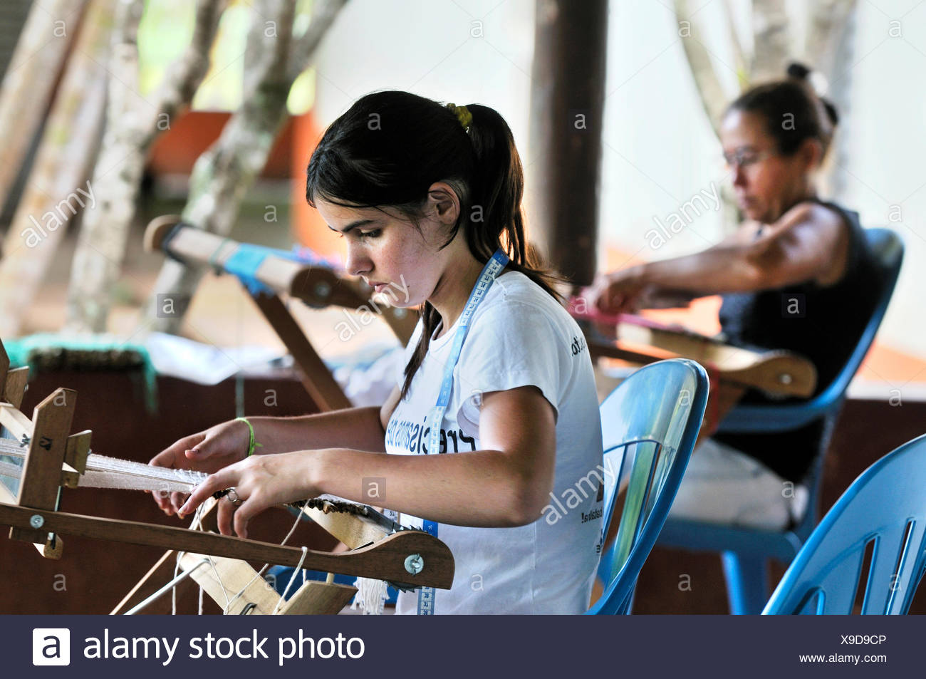Crafts, women weaving table mats with dried banana leaves, settlement of the Brazilian Landless Workers' Movement Movimento dos Stock Photo